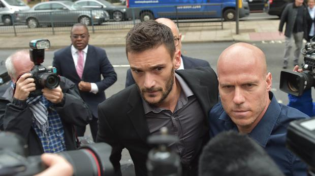 Tottenham goalkeeper Hugo Lloris (centre) arrives at Westminster Magistrates' Court (Nick Ansell/PA)