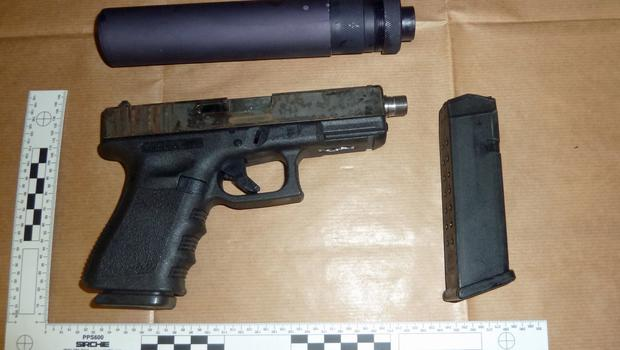 Weapons, ammunition and cash were seized (National Crime Agency/PA)