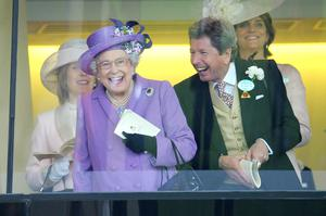 The Queen celebrating a win with her racing manager John Warren at Ascot in 2013 (Tim Ireland/PA)