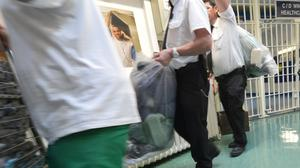 File photo of inmates and prison guards move items inside a prison. Some 19 inmates have tested positive for coronavirus across 10 jails, the Ministry of Justice said (Anthony Devlin/PA).
