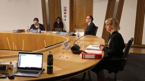 The Scottish Government was advised by Police Scotland to refer potentially-criminal harassment claims rather than investigate them itself, the committee heard (Andrew Milligan/PA)