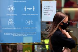 Face coverings are already mandatory in shops in Scotland (Andrew Milligan/PA)