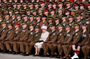 The Queen joins soldiers of the Royal Scots Dragoon Guards for a regimental photograph