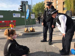 Police talk to a protester in Euston, London (HS2 Rebellion/PA)