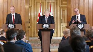 (left to right) Chief Medical Officer for England Chris Whitty, Prime Minister Boris Johnson and Chief Scientific Adviser Sir Patrick Vallance during a press conference at Downing Street, London, on the government's coronavirus action plan (Frank Augstein/PA).