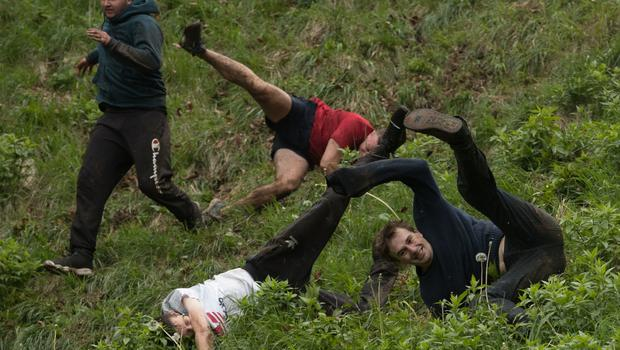 The cheese is chased 200 yards down the 1:2 gradient Cooper's Hill at Brockworth (Aaron Chown/PA)