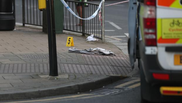 An item of clothing lies on the pavement in Wealdstone, near where two boys, aged 13 and 15, were shot (Jonathan Brady/PA)