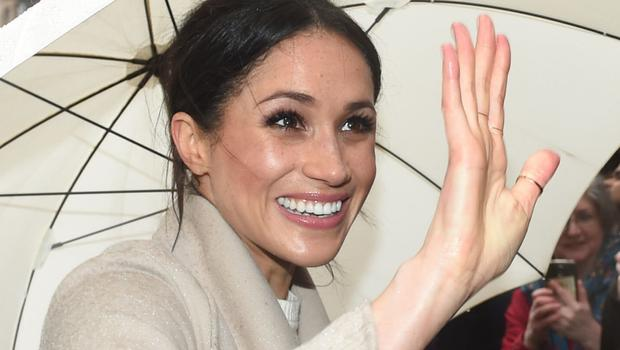 Meghan Markle waving to well wishers during a royal visit to Belfast