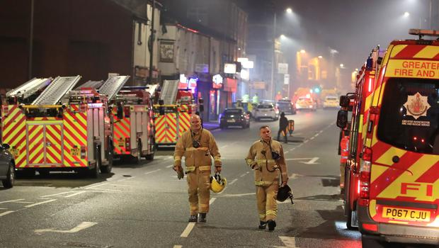 Firefighters at the scene after a fire on the top floors of a building on Bradshawgate in Bolton (Peter Byrne/PA)