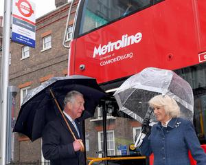 The Prince of Wales and Duchess of Cornwall prepare to board a new electric double-decker bus at Clarence House in London (Stuart Wilson/PA)