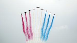 The Red Arrows perform a flypast over Scarborough Castle (Danny Lawson/PA)