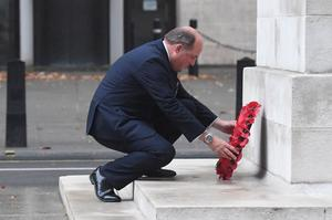 Defence Secretary Ben Wallace lays a wreath at the Centotaph in Whitehall (PA)