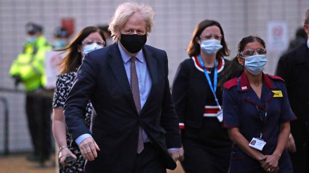 Prime Minister Boris Johnson arriving at the Westminster Bridge Vaccination Centre at St Thomas' Hospital, London, to receive his Covid-19 vaccine (Aaron Chown/PA)
