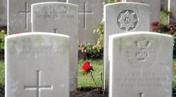 A rose grows between the headstones at the Commonwealth War Graves Commission's Wytschaete Military Cemetery, near Ypres, Belgium (Gareth Fuller/PA)