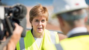 First Minister Nicola Sturgeon during a visit to the site of Aberdeen Harbour's Nigg Bay Expansion in the east of Scotland (PA)