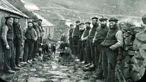 Men on either side of the street forming the St Kilda Parliament on the island of Hirta (National Trust for Scotland/PA)