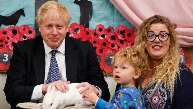 Boris Johnson holds a rabbit during a visit to West Monkton Primary School in Taunton, Somerset yesterday