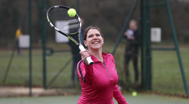 Liberal Democrat Leader Jo Swinson playing tennis as she visits Shinfield Tennis Club (Aaron Chown/PA)