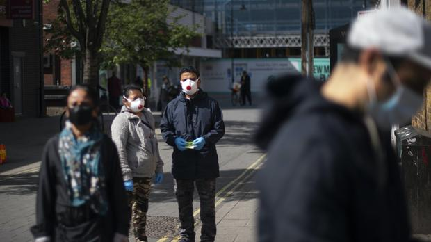 Protective face masks could become a lot more common on the UK's streets (Victoria Jones/PA)