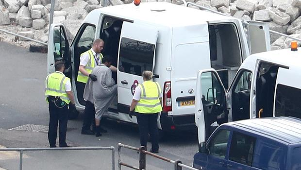 The group were searched and taken away in vans (Gareth Fuller/PA)