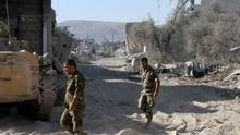 Syrian army soldiers are seen deployed in the Jobar neighbourhood of Damascus (AP)