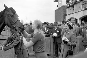 The Queen is all smiles after Highclere wins the 1000 Guineas at Newmarket in 1974 (PA)