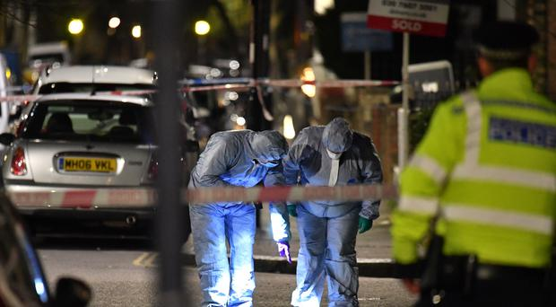 Forensic officers at the scene (Dominic Lipinski/PA)