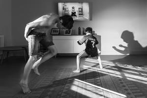 Children taking part in the Joe Wicks PE sessions in the living room of their home in Beckenham, south London (Francesca Brecciaroli/Historic England/PA)