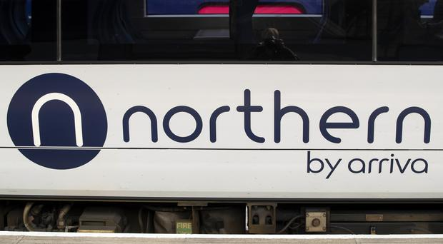 A demonstration was held in Manchester calling for Northern to lose its franchise (Danny Lawson/PA)