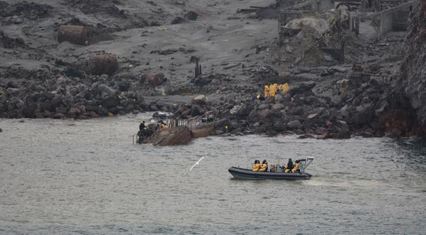 An operation to recover bodies from White Island after a volcanic eruption in New Zealand, (New Zealand Defence Force/AP)