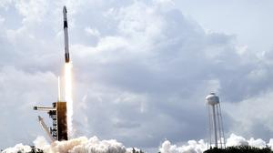 The SpaceX Falcon 9 carrying two US astronauts lifts off from Kennedy Space Centre in Florida (John Raoux/AP)