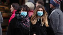 People wearing face masks in central London (Yui Mok/PA)