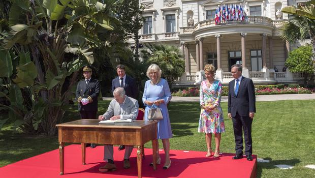 The Prince of Wales and Duchess of Cornwall sign the visitors' book at the Villa Massena in Nice, France (Arthur Edwards/The Sun/PA)