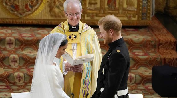 Harry and Meghan exchanging vows in St George's Chapel (Owen Humphreys/PA)