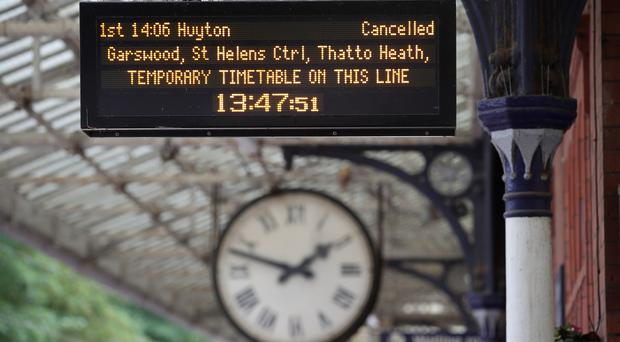 A tougher punctuality standard has been introduced by Britain's rail industry (Nick Potts/PA)