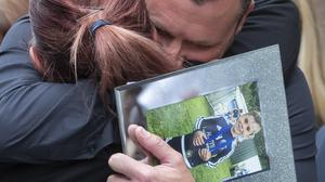 Andrew Metcalf holds a photograph of his son Stanley Metcalf, after making a statement to media outside Sheffield Crown Court after Albert Grannon was jailed for three years after he shot dead his six-year-old great-grandson as he checked his unlicensed air rifle.