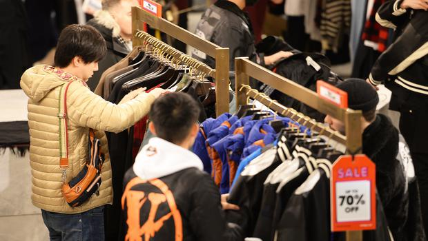 Shoppers search for bargains in the sale at Selfridges on Oxford Street, London (PA)