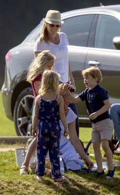 The Duchess of Cambridge (sitting) with Prince George and Autumn Phillips and her children, Savannah and Isla, as her husband the Duke of Cambridge takes part in the Maserati Royal Charity Polo Trophy at the Beaufort Polo Club, Downfarm House, Westonbirt, Tetbury (Steve Parsons/PA)