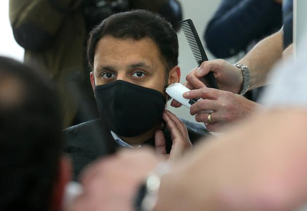 Scottish Labour leader Anas Sarwar has his hair cut by barber Mark Stephen at Oceanic Hair Salon in Glasgow (Andrew Milligan/PA)