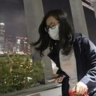 A passenger wears a face mask at a train station in Hong Kong (Kin Cheung/AP)