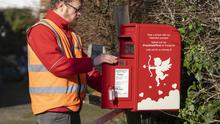 Postman Dan Bennett collecting the mail in Lover, Wiltshire. (PA/Royal Mail)