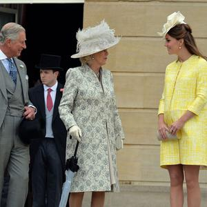 The Prince of Wales, the Duchess of Cornwall and Duchess of Cambridge at the garden party in the grounds of Buckingham Palace (PA)