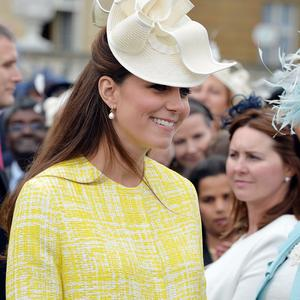 The Duchess of Cambridge, who is seven months pregnant, talks to guests (PA)