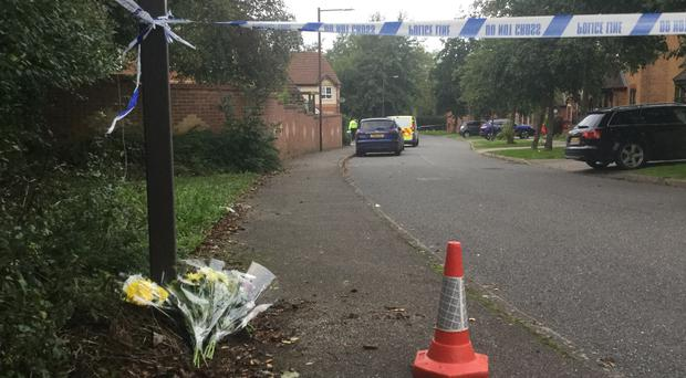 Flowers left at a housing estate in Emerson Valley, Milton Keynes, where two teenage boys were stabbed to death (Gus Carter/PA)