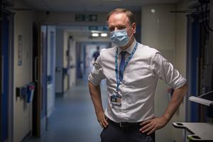 Sir Simon Stevens, chief executive of the NHS, visiting the NHS Seacole Centre at Headley Court, Surrey (Victoria Jones/PA)