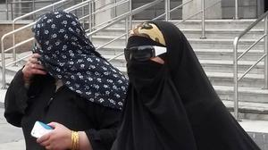 Runa Khan (right) leaving court after she admitted posting messages encouraging terrorism in Syria