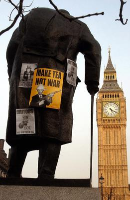 The statue was covered in anti-war posters in 2003 after crowds gathered to opposing the war in the Gulf (John Stillwell/PA)