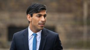 Chancellor Rishi Sunak has said ministers will decide on whether to ease the two-metre rule (Dominic Lipinski/PA)