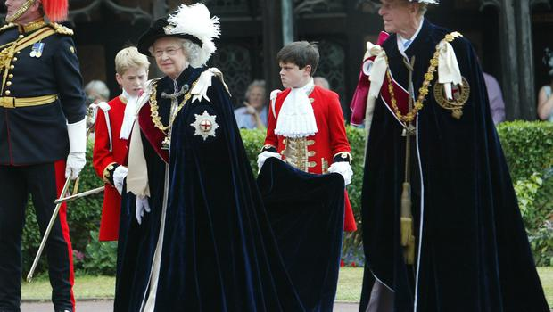 The Queen and the Duke of Edinburgh in their Order of the Garter robes. The Order was founded by Edward III (PA)
