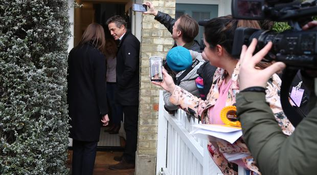 Actor Hugh Grant canvassing in Walton-on-Thames in the Esher and Walton constituency with Liberal Democrat candidate Monica Harding (Gareth Fuller/PA)